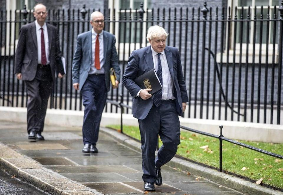 Boris Johnson leads Sir Patrick Vallance and Professor Chris Whitty to the Downing Street news conference (Richard Pohle/The Times/PA) (PA Wire)