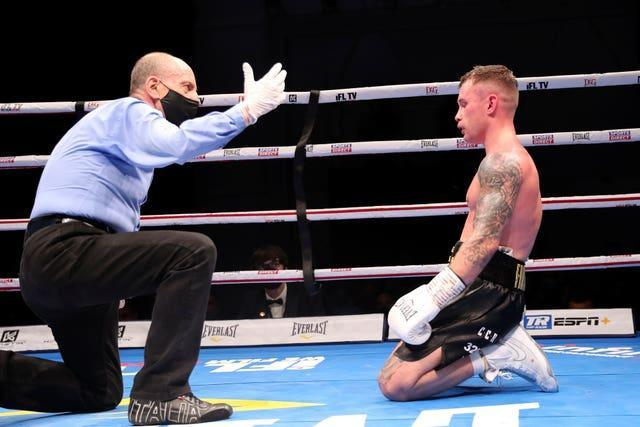 Carl Frampton is knocked down for a second time in his WBO super-featherweight title fight with Jamal Herring in Dubai and later announced his retirement