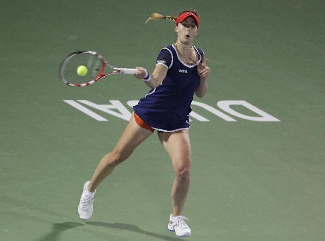 Alize Cornet of France returns the ball to Venus Williams of the U.S. during the final match of Dubai Duty Free Tennis Championships in Dubai, United Arab Emirates, Saturday Feb, 22, 2014. (AP Photo/Kamran Jebreili)