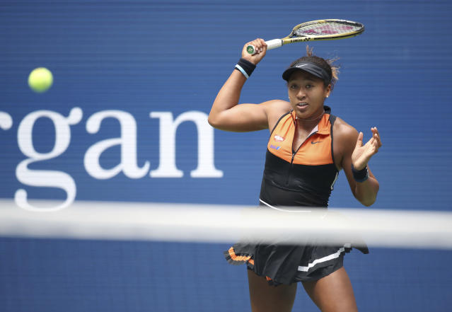 Naomi Osaka, of Japan, returns a shot to Anna Blinkova, of Russia, during the first round of the US Open tennis tournament Tuesday, Aug. 27, 2019, in New York. (AP Photo/Michael Owens)