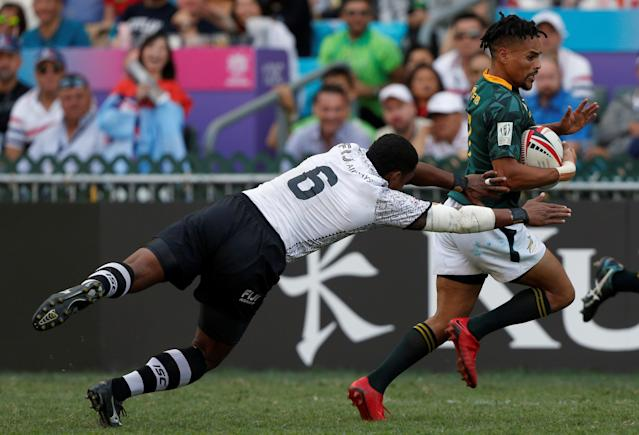 Rugby Union - Fiji v South Africa - World Rugby Sevens Series - Hong Kong Stadium, Hong Kong, China - April 8, 2018 - South Africa's Selvyn Davids is tackled by Fiji's Samisoni Viriviri. REUTERS/Bobby Yip