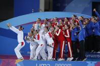 Canada, gold medalists, center, Mexico, silver medalists, left, and the U.S., bronze medalists, right, pose for a selfie after the medals ceremony for team competition free artistic swimming at the Pan American Games in Lima, Peru, Wednesday, July 31, 2019. (AP Photo/Moises Castillo)
