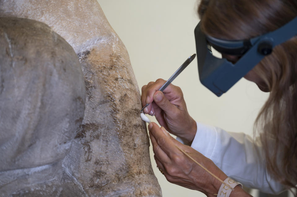 A restorer works on one of Michelangelo's Pieta sculpture in Florence, Italy, Tuesday, Sept. 8, 2020. A restoration of one of Michelangelo's Pieta sculptures has uncovered previously unknown details, including the artist's tool marks, that had been hidden under centuries of dust and wax. Florence's Museo dell'Opera del Duomo said Wednesday, Sept. 16, 2020 that the cleaning of the Bandini Pieta, which began last year but was suspended because of the coronavirus pandemic, had resumed and that the public was now invited to watch restorers at work. Michelangelo carved the Bandini Pieta between 1547-1555, when he was nearly 80. (Claudio Giovannini/Opera di Santa Maria del Fiore via AP)