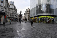 A nearly empty Leicester Square, in London, Tuesday, Nov. 24, 2020. Haircuts, shopping trips and visits to the pub will be back on the agenda for millions of people when a four-week lockdown in England comes to an end next week, British Prime Minister Boris Johnson said Monday. (AP Photo/Alberto Pezzali)