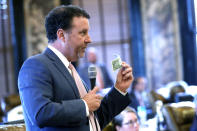 """Sen. David Parker, R-Olive Branch, asks about the """"In God We Trust"""" motto on legal tender and how it might be safeguarded for use on the new state flag as required by proposed legislation for changing Mississippi's current state flag Sunday, June 28, 2020 at the Capitol in Jackson, Miss. The bill to change the state flag passed 37-14. Both chambers of the Mississippi Legislature passed the bill to take down the state flag, which contains the Confederate battle emblem. (AP Photo/Rogelio V. Solis)"""