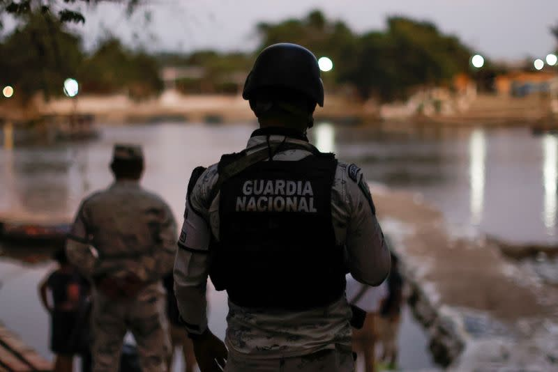 Members of the National Guard keep watch at the banks of the Suchiate river, while they guard the border to prevent a migrant caravan of Central Americans from entering, in Ciudad Hidalgo