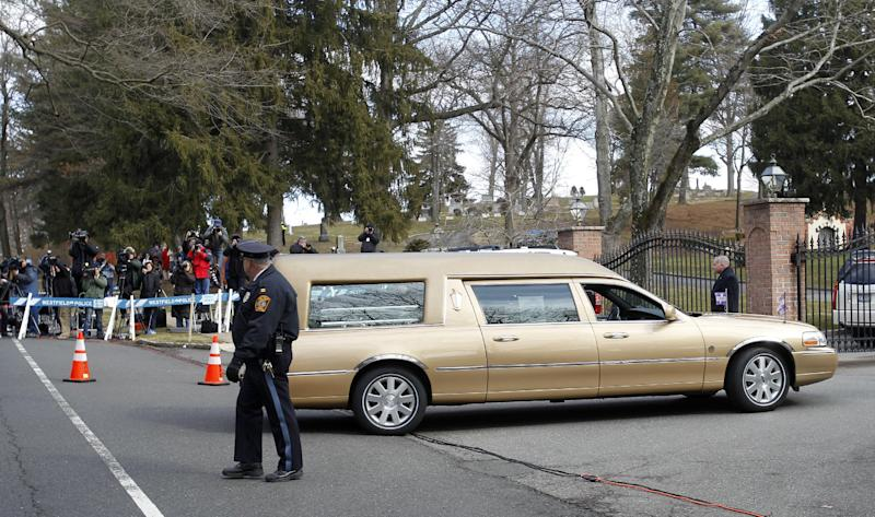 The hearse carrying the body of Whitney Houston arrives at Fairview Cemetery for her burial in Westfield, N.J., Sunday, Feb. 19, 2012. (AP Photo/Rich Schultz)