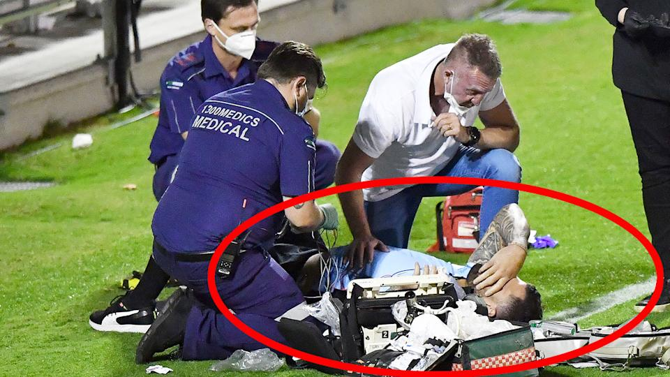 Pictured here, paramedics treat Andrew Fifita after the scary incident.