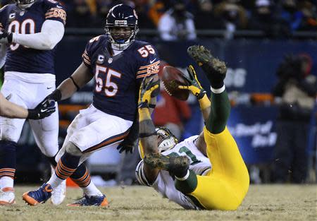 Dec 29, 2013; Chicago, IL, USA; Green Bay Packers tight end Andrew Quarless (81) attempts to make a catch against Chicago Bears outside linebacker Lance Briggs (55) during the fourth quarter at Soldier Field. The Green Bay Packers win 33-28. Mandatory Credit: Mike DiNovo-USA TODAY Sports
