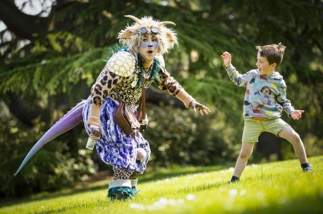 Hamish Lamont, aged five, meets 'The Undiscovered Creature' during a performance at the Royal Botanic Garden Edinburgh for the 2021 Edinburgh International Children's Festival