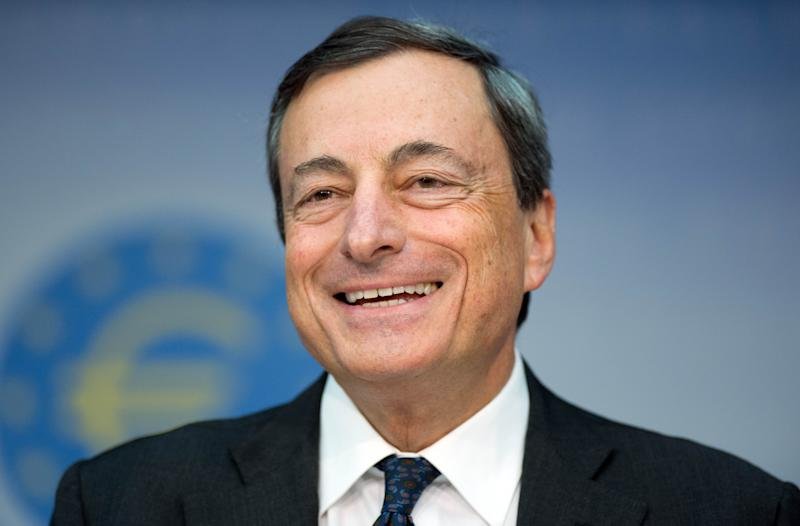 President of European Central Bank, ECB, Mario Draghi speaks during a news conference in Frankfurt, Germany, Thursday, Aug. 1, 2013. Draghi held the door open for another interest rate cut if the struggling euro area economy needs more stimulus. Draghi spoke Thursday after the ECB left its benchmark interest rate unchanged at 0.5 percent. (AP Photo/Boris Roessler)