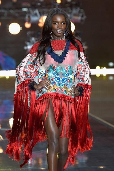 <p>Leomie Anderson was the most covered up model of the night in a poncho with red fringe. </p>