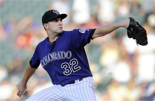 Colorado Rockies starting pitcher Tyler Chatwood throws in the first inning of a baseball game against the Miami Marlins in Denver on Saturday, Aug. 18, 2012. (AP Photo/Chris Schneider)
