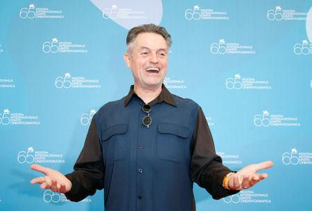 FILE PHOTO: U.S. director Jonathan Demme poses for photographers during a photocall at the Venice Film Festival in Venice, Italy, September 3, 2008.  REUTERS/Denis Balibouse/File Photo