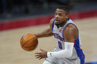 Detroit Pistons guard Dennis Smith Jr. drives to the basket during the second half of an NBA basketball game against the Sacramento Kings, Friday, Feb. 26, 2021, in Detroit. (AP Photo/Carlos Osorio)