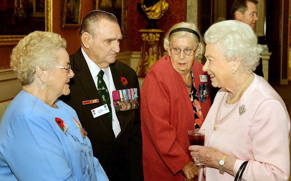 The Queen talking to Margaret Purves GC, right, at a reunion reception for the Victoria and George Cross Association in Buckingham Palace, October 2014 - John Stillwell/WPA Pool/Getty Images