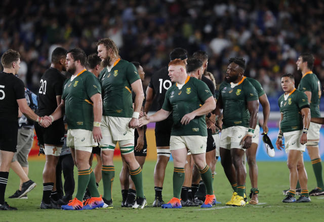 New Zealand and South African players greet each other at the end of the Rugby World Cup Pool B game in Yokohama, Japan, Saturday, Sept. 21, 2019. (AP Photo/Shuji Kajiyama)