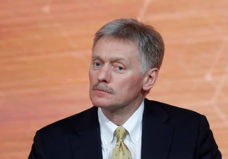 Kremlin spokesman Dmitry Peskov listens during Russian President Vladimir Putin's annual end-of-year news conference in Moscow