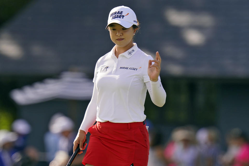 Sei Young Kim, of South Korea, waves to the gallery after making a birdie putt on the 14th hole during the final round of the LPGA Pelican Women's Championship golf tournament Sunday, Nov. 22, 2020, in Belleair, Fla. (AP Photo/Chris O'Meara)