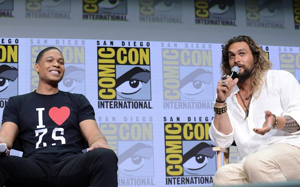 "Ray Fisher and Jason Momoa attend the Warner Bros. Pictures ""Justice League"" presentation during Comic-Con International 2017. (Photo by Albert L. Ortega/Getty Images)"