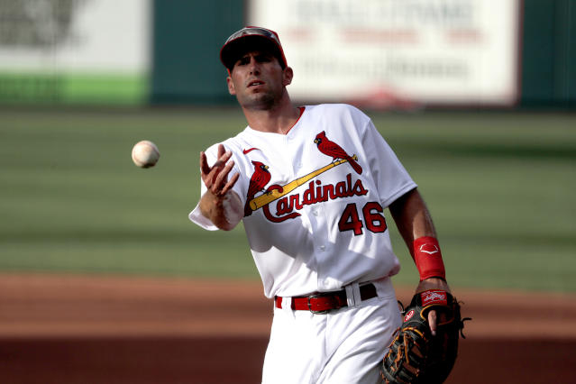 St. Louis Cardinals infielder Paul Goldschmidt tosses a ball toward the dugout during an intrasquad practice baseball game at Busch Stadium Thursday, July 9, 2020, in St. Louis. (AP Photo/Jeff Roberson)