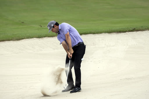 Robert Streb hits out of the bunker on the 10th fairway during the final round of the RSM Classic golf tournament, Sunday, Nov. 22, 2020, in St. Simons Island, Ga. (AP Photo/Stephen B. Morton)