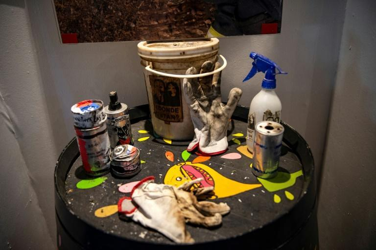 Empty tear gas cartridges, gloves and other objects used in Chile's social protests are displayed at the Social Uprising Museum, which opened in Santiago in November 2020