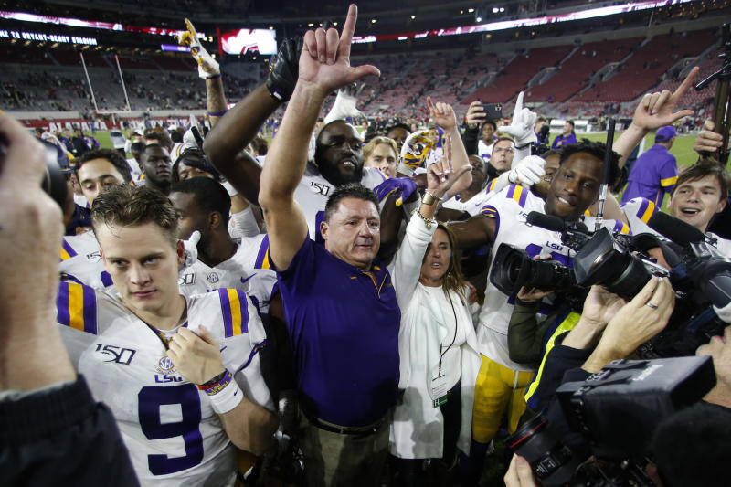 LSU head coach Ed Orgeron celebrates with his players after defeating Alabama 46-41 in an NCAA college football game, Saturday, Nov. 9, 2019, in Tuscaloosa , Ala. (AP Photo/John Bazemore)