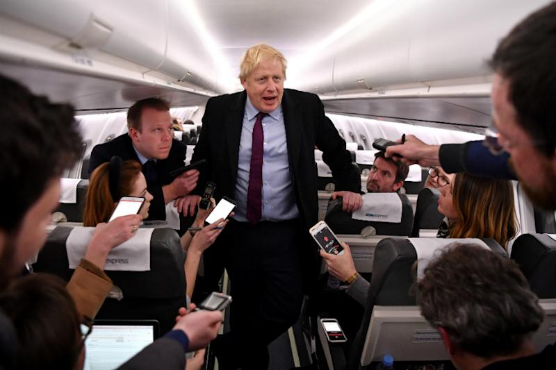 Boris Johnson Pockets Reporter's Phone after He Shows Him Photo of Sick Boy Lying on Pile of Coats