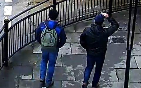 Both suspects are pictured from behind on Fisherton Road - Credit: Metropolitan Police