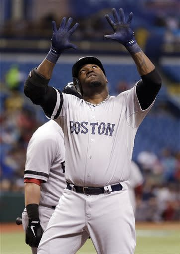 Boston Red Sox's David Ortiz looks skyward after crossing home plate following his first-inning, three-run home run off Tampa Bay Rays starting pitcher Matt Moore during a baseball game Tuesday, May 14, 2013, in St. Petersburg, Fla. Red Sox's Jacoby Ellsbury, and Dustin Pedroia also scored on the hit. (AP Photo/Chris O'Meara)