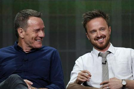 "Cranston smiles with Paul at a panel for the television series ""Breaking Bad"" during the AMC portion of the Television Critics Association Summer press tour in Beverly Hills"