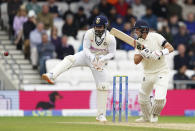 England captain Joe Root, right, plays a shot during the second day of third test cricket match between England and India, at Headingley cricket ground in Leeds, England, Thursday, Aug. 26, 2021. (AP Photo/Jon Super)