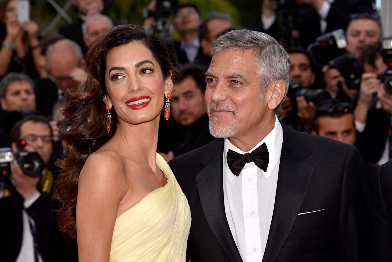 <p>Amal's loose-lipped hairdresser, Miguel Perez, confirmed the new mum would attend the nuptials with husband George. [Photo: Getty] </p>