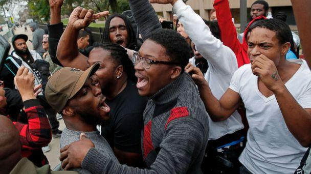 PHOTO: People celebrate the guilty verdict in the murder trial of Chicago police officer Jason Van Dyke outside the Leighton Criminal Court Building in Chicago, Oct. 5, 2018. Van Dyke was found guilty of murder for fatally shooting Laquan McDonald. (Jim Young/AFP/Getty Images)