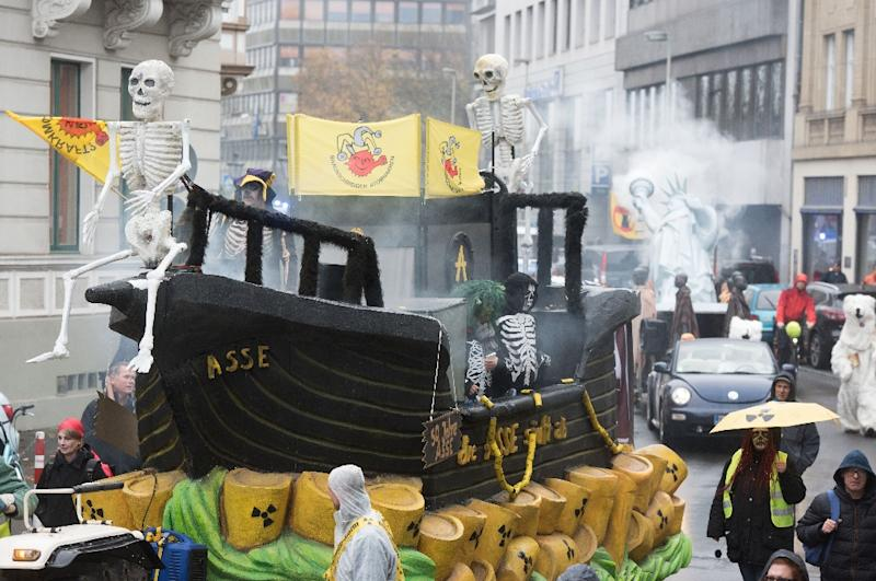 Demonstrators dressed as human skeletons stand on a ship-designed float swimming on symbolical nuclear waste during a protest of the action group 'No Climate Change', in Bonn, Germany, on November 11, 2017 (AFP Photo/Bernd Thissen)
