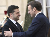 French President Emmanuel Macron, right, greets Ukrainian President Volodymyr Zelenskiy before a meeting at the Elysee Palace, Paris, France, Monday, Dec. 9, 2019. A long-awaited summit in Paris is aiming to find a way to end the war in Ukraine, after five years and 14,000 lives lost in a conflict that has emboldened the Kremlin and reshaped European geopolitics. (Alexei Nikolsky, Sputnik, Kremlin Pool Photo via AP)