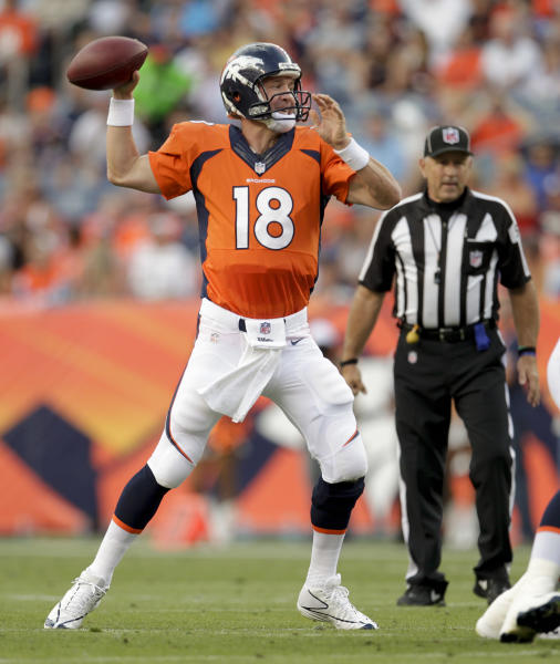 Denver Broncos quarterback Peyton Manning (18) passes against the St. Louis Rams in the second quarter of a preseason NFL football game, Saturday, Aug. 24, 2013, in Denver. (AP Photo/Joe Mahoney)