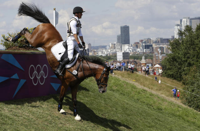 Peter Thomsen of Germany competes in the equestrian eventing cross country phase at the 2012 Summer Olympics, Monday, July 30, 2012, in London. (AP Photo/Ng Han Guan)