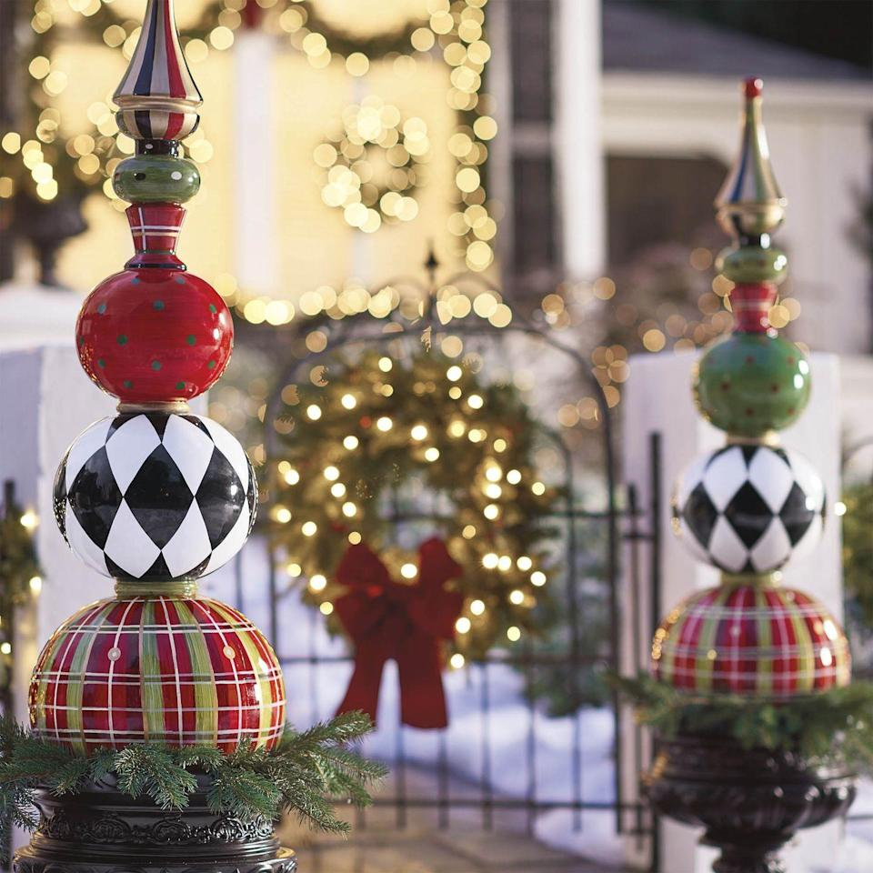 <p>Welcome carolers or holiday soiree guests with a beautiful entryway complete with whimsical topiaries and a lit Christmas wreath. </p>