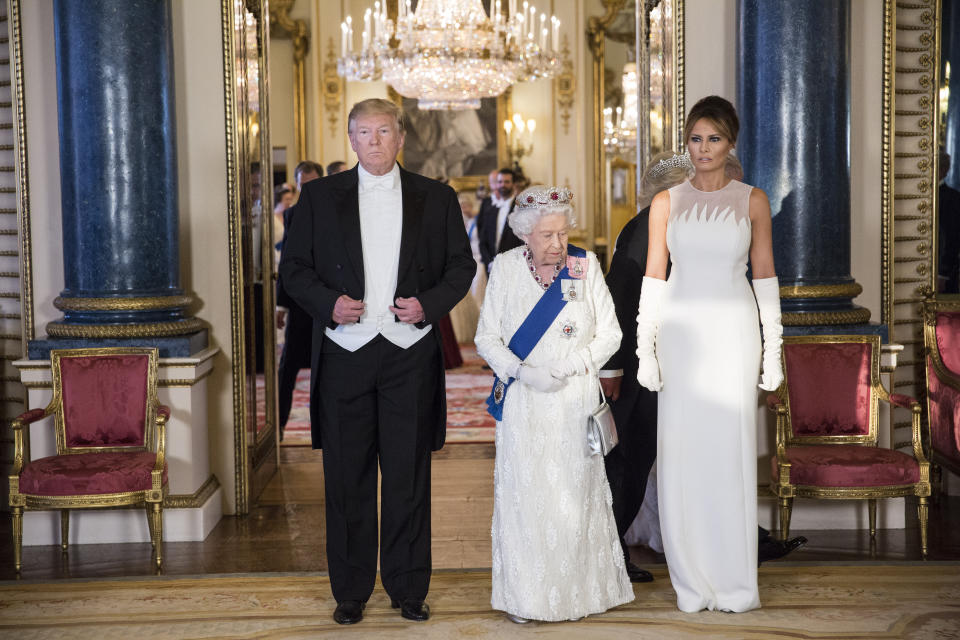 RETRANSMITTED CORRECTING BYLINE (left to right) US President Donald Trump, Queen Elizabeth II and Melania Trump, during a group photo ahead of the State Banquet at Buckingham Palace, London, on day one of US President Donald Trump's three day state visit to the UK.