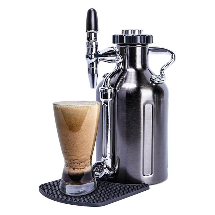 """<p><strong>GrowlerWerks</strong></p><p>amazon.com</p><p><strong>$198.30</strong></p><p><a href=""""https://www.amazon.com/dp/B07X1LXC4X?tag=syn-yahoo-20&ascsubtag=%5Bartid%7C10060.g.36727477%5Bsrc%7Cyahoo-us"""" rel=""""nofollow noopener"""" target=""""_blank"""" data-ylk=""""slk:Shop Now"""" class=""""link rapid-noclick-resp"""">Shop Now</a></p><p>The 12-cup capacity uKeg Nitro creates nitro cold brew at home. The all-in-one system cold-brews the coffee while infusing it with nitro gas, giving it a creamy mouthfeel. </p><p>Users love the quality of this nitro cold brew, which costs a fraction of the price when buying cold-brew nitro retail. One called it an """"affordable luxury."""" However, others point out that nitro gas chargers are not included in the already pricey package. </p>"""