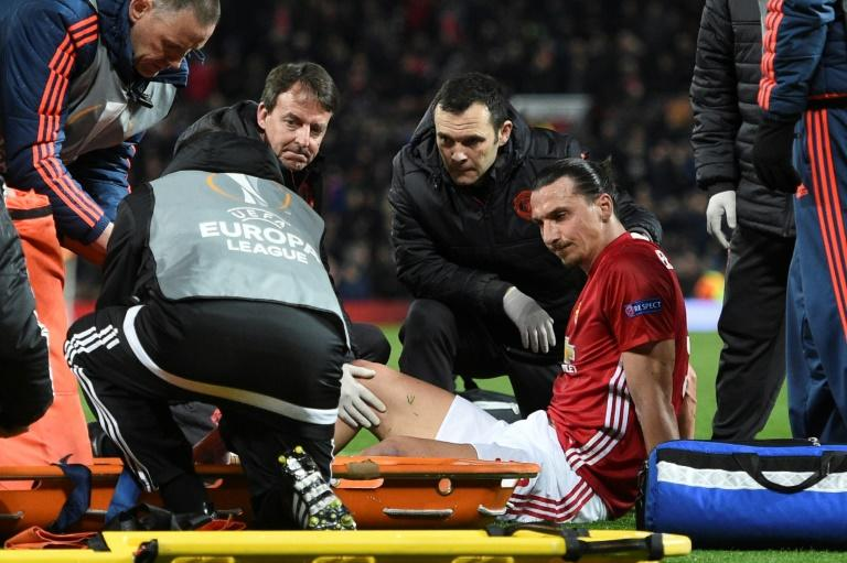 Zlatan Ibrahimovic gets treatment after injuring his knee during Manchester United's UEFA Europa League quarter-final second leg against Anderlecht at Old Trafford in Manchester, on April 20, 2017