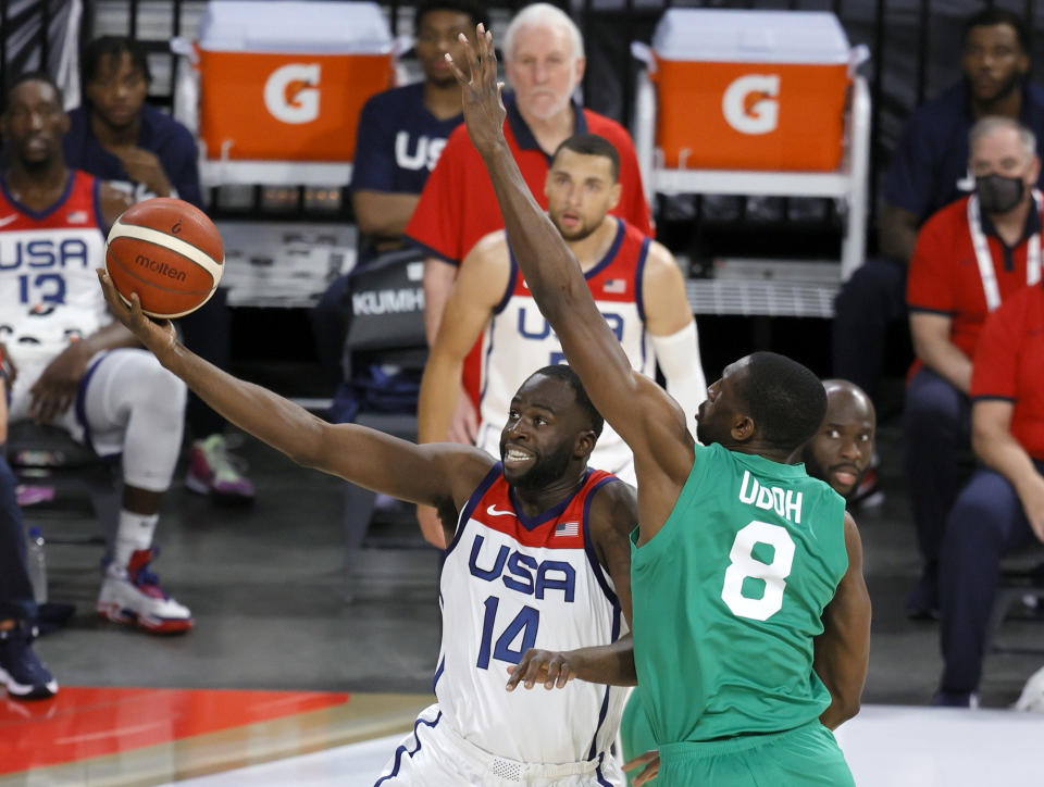 LAS VEGAS, NEVADA - JULY 10:  Draymond Green #14 of the United States drives to the basket against Ekpe Udoh #8 of Nigeria during an exhibition game at Michelob ULTRA Arena ahead of the Tokyo Olympic Games on July 10, 2021 in Las Vegas, Nevada.  (Photo by Ethan Miller/Getty Images)