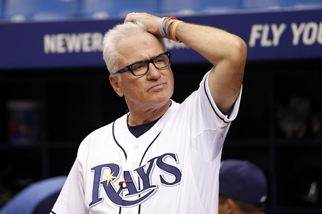 ST. PETERSBURG, FL - JUNE 5: Manager Joe Maddon #70 of the Tampa Bay Rays looks on from the field before a moment of silence in honor of the late Don Zimmer, a senior baseball advisor for the Rays, before the start of a game against the Miami Marlins on June 5, 2014 at Tropicana Field in St. Petersburg, Florida. (Photo by Brian Blanco/Getty Images)