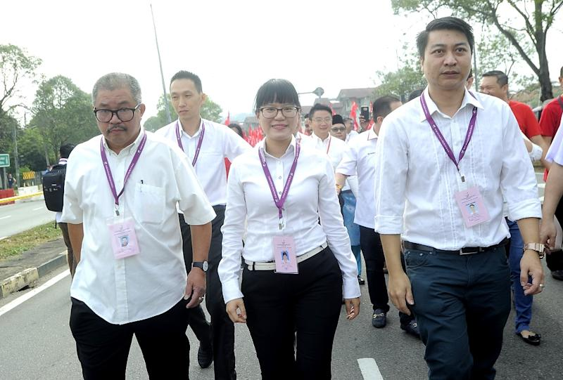 Pakatan Harapan's candidate for the Balakong by-election, Wong Siew Ki (centre) and supporters arrive at the nomination centre in Bangi August 18, 2018.