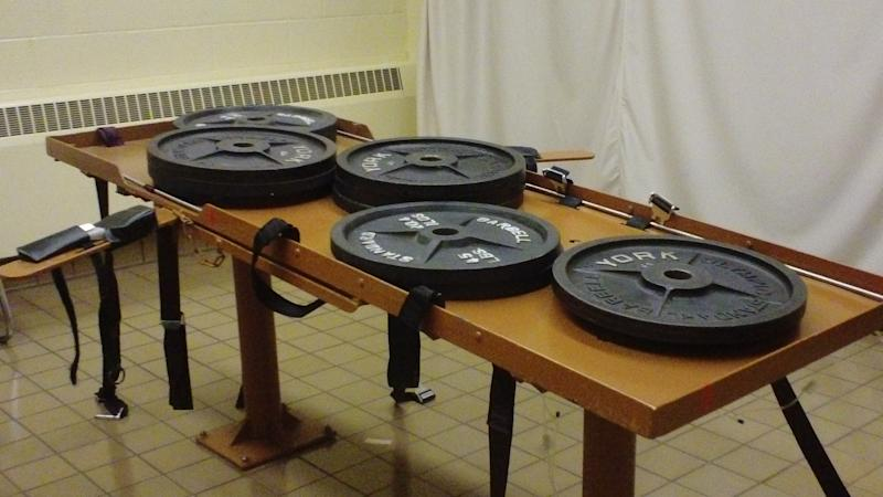 This undated photo provided by the Ohio Department of Rehabilitation and Corrections shows 540 pounds of weights placed on the execution table at the Southern Ohio Correctional Facility in Lucasville, Ohio to test the table's load bearing. Ohio death row inmate Ronald Post, scheduled for execution Jan. 16, 2013, is arguing that, at 450 pounds, can not be humanely executed under both the state's usual method and the untested backup procedure. (AP Photo/Ohio Dept. of Rehabilitation and Corrections)