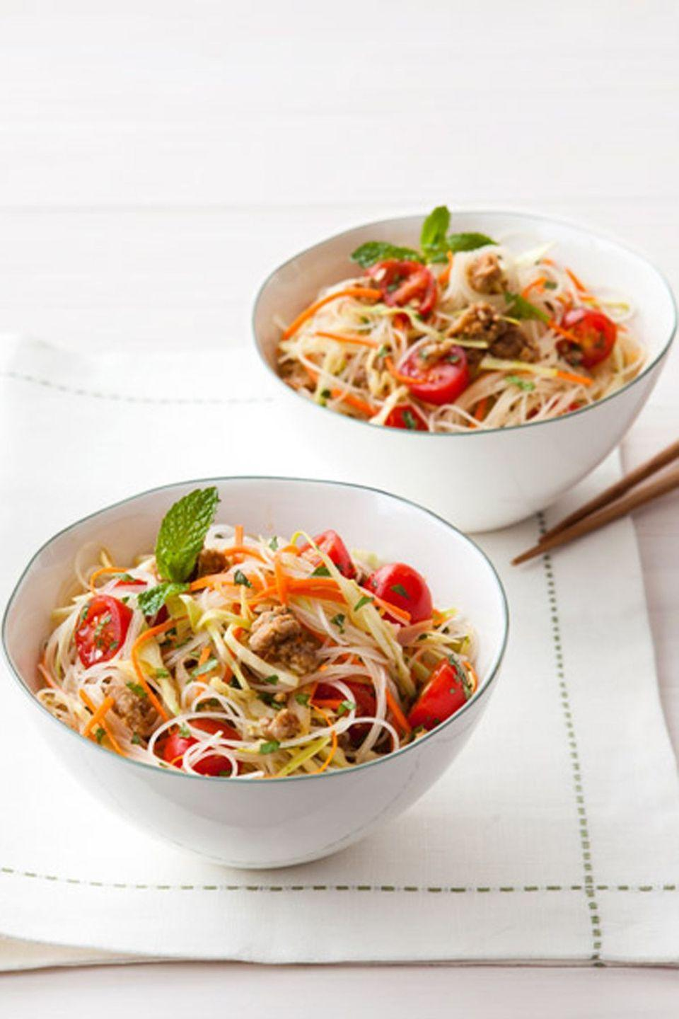 "<p>For those who want a little extra kick to their noodles, this Thai dish serves up just the right amount of flavor.</p><p><em><strong><a href=""https://www.womansday.com/food-recipes/food-drinks/recipes/a39527/spicy-thai-noodle-salad-recipe-ghk0314/"" rel=""nofollow noopener"" target=""_blank"" data-ylk=""slk:Get the Spicy Thai Noodle Salad recipe"" class=""link rapid-noclick-resp"">Get the Spicy Thai Noodle Salad recipe</a>.</strong></em></p>"