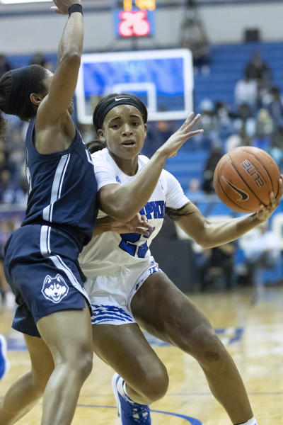 Memphis guard Jamirah Shutes, right, drives defended by Connecticut guard Christyn Williams, left, in the first half of an NCAA college basketball game Tuesday, Jan. 14, 2020, in Memphis, Tenn. (AP Photo/Nikki Boertman)