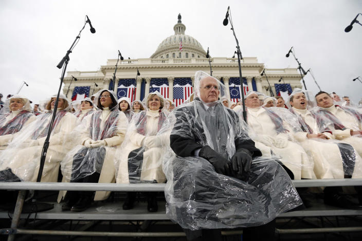 <p>Members of the Mormon Tabernacle Choir sit in the rain waiting for the swearing in of Donald Trump as the 45th president of the United States to begin during the 58th Presidential Inauguration at the U.S. Capitol in Washington. Friday, Jan. 20, 2017. (Photo: Carolyn Kaster/AP) </p>